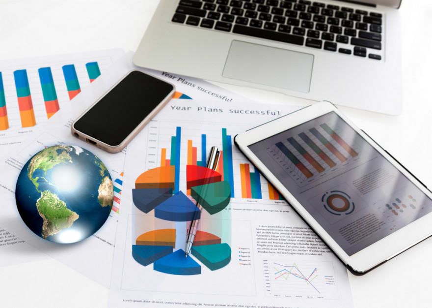 Financial charts on the table with tablet phone and pen  (Elements of this image furnished by NASA)